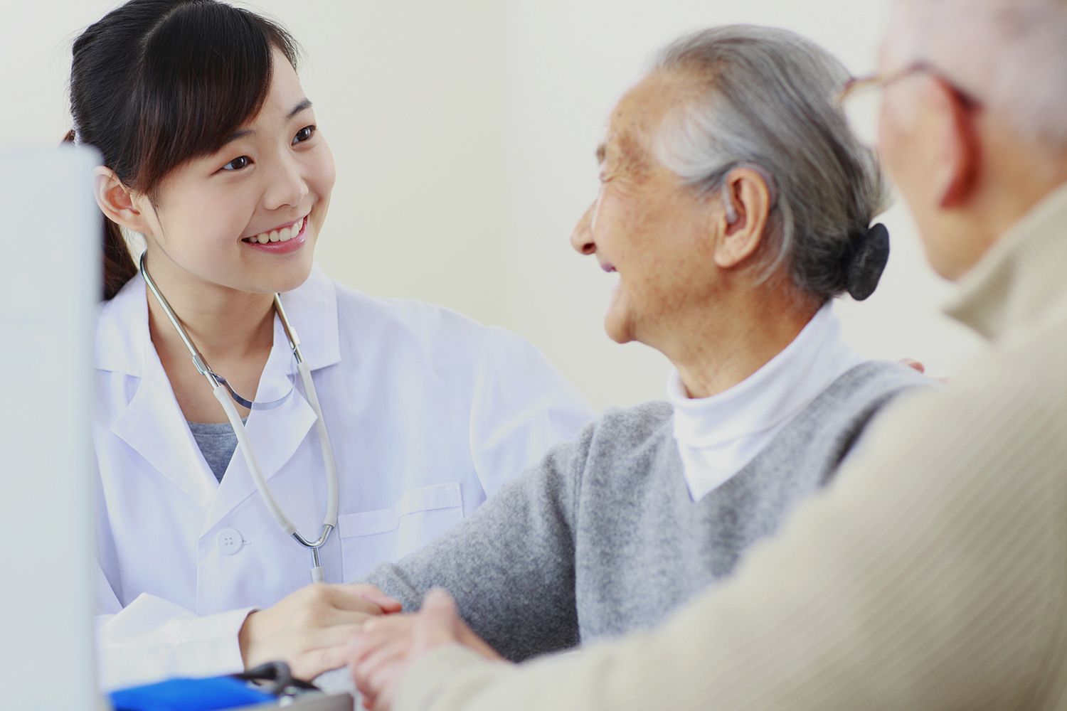 pretty young asian doctor with seniors